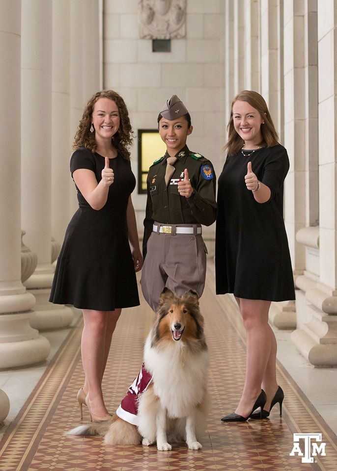 Hannah Wimberly, Student Body President, Cecille Sorio, Commander of the Corps of Cadets, and Claire Wimberly, President of the Senior Class make the Gig 'em hand sign while standing behind Reveille